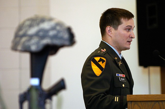 Capt. Mike Dolan, rear detachment commander of 3rd Battalion, 82nd Field Artillery Regiment, 2nd Brigade Combat Team, 1st Cavalry Division, speaks about his service with Staff Sgt. Leroy Webster, during a memorial service held for Pfc. James McCoy and Webster May 21, at the Ironhorse Chapel on Fort Hood, Texas.