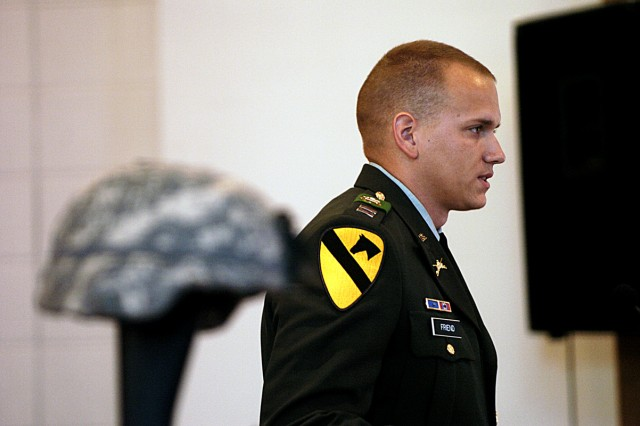 Capt. Pete Friend, rear detachment commander of 1st Battalion, 8th Cavarly Regiment, 2nd Brigade Combat Team, 1st Cavalry Division, speaks about his service with Pfc. James McCoy, during a memorial service held for McCoy and Staff Sgt. Leroy Webster May 21, at the Ironhorse Chapel on Fort Hood, Texas.
