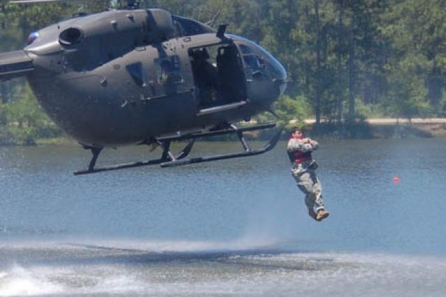 Third of three photos showing the jump of a 1st Battalion (Airborne), 509th Infantry Regiment Soldier as he jumps from a Lakota into Fort Polk's Alligator Lake.