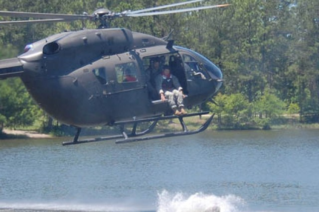 FORT POLK, La. -- A Soldier with Headquarters and Headquarters Detachment, 1st Battalion (Airborne), 509th Infantry Regiment, jumps into the chilly waters of Alligator Lake May 20 -- and makes a little history. It was the first time the Lakota helicopter was used to drop personnel into a lake. The exercise was also a send-off for the Soldiers before they take block leave for the summer. These three photos show the jump in progression.