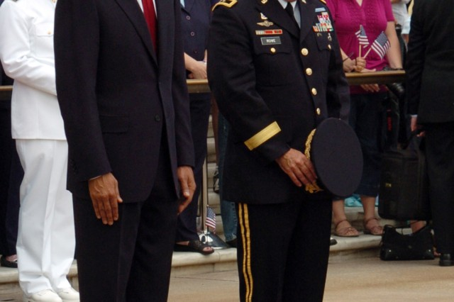 President Barack H. Obama and Maj. Gen. Richard J. Rowe Jr., bow their heads in reflection after President Obama presented a wreath at the Tomb of the Unknown Soldier in Arlington National Cemetery.