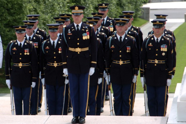 A platoon of Soldiers from Honor Guard Company, 4th Battalion, 3rd U.S. Infantry Regiment (The Old Guard), stand during a presidential wreath laying ceremony at the Tomb of the Unknown Soldier in Arlington National Cemetery.  The platoon is led by Capt. John Johnson.