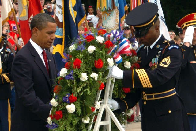 Assisted by Sergeant of the Guard Sgt. 1st Class Alfred Lanier, President Barack H. Obama places a wreath at the Tomb of the Unknown Soldier in Arlington National Cemetery.  Obama presented the wreath to honor those who have made the ultimate sacrifice while defending the United States.