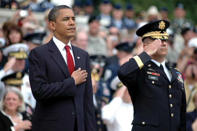 President Barack Obama and Maj. Gen. Richard J. Rowe Jr., commanding general, Joint Force Headquarters-National Capital Region and Military District of Washington, salute the fallen at Arlington National Cemetery after laying a wreath at the Tomb of the Unknowns, Monday.