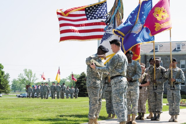 U.S. Army Ordnance Center and Schools Regimental Command Sgt. Maj. Daniel A. Eubanks, left, and Brig. Gen. Lynn A. Collyar, commander of OC&S and chief of Ordnance, center, case the OC&S colors held by Sgt. 1st Class Mundrickus Kelly during the organization's color casing ceremony at Ordnance Circle on Aberdeen Proving Ground, Md., May 8.