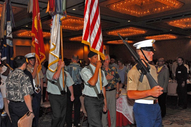 HONOLULU, Hawaii - A joint service color guard approaches the stage at the 24th annual Military Recognition Luncheon. Servicemembers from all branches of the U.S. military were honored at the luncheon, as well as community and business leaders from throughout the island.