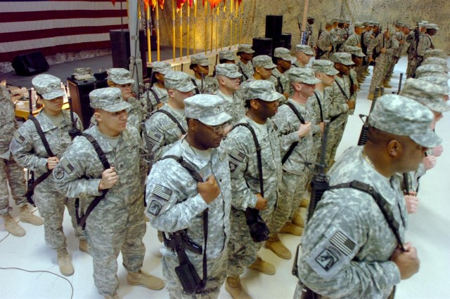 The 330th Transportation Battalion Soldiers wait in formation during their transfer of authority ceremony at Joint Base Balad, Iraq May 16. The 49th Trans. Bn., will assume command of the 330th Trans. Bn. mission and responsibilities providing logistics and distribution support throughout Iraq.