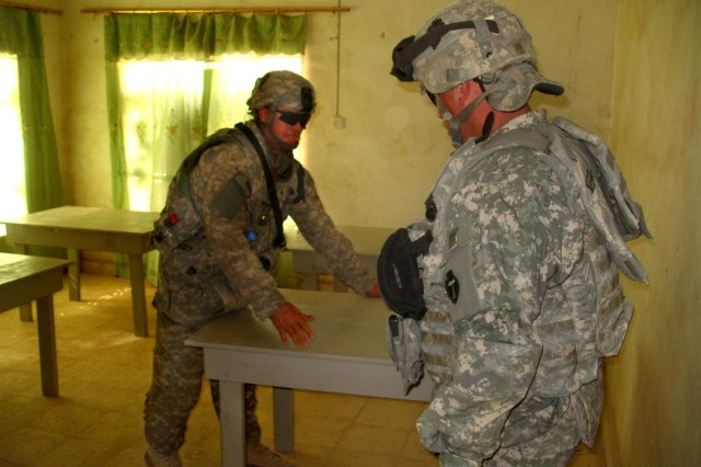Soldiers from the Texas Army National Guard, Alpha Company, 56th Brigade Troop Support Battalion delivered 25 desks, 50 benches and five bookcases-which they hand crafted- help furnish the Hand of Mercy Orphanage in Al Batha, Dhi Qar province, Iraq April 23