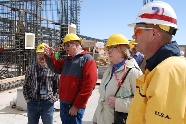 Members of the Colorado Chemical Demilitarization Citizen's Advisory Commission toured the PCAPP site in April. John Thatcher (red jacket) and Irene Kornelly ask questions of Gary Anderson, PCAPP site project manager (right), and Mark Hunter, Bechtel lead field civil engineer (far left).
