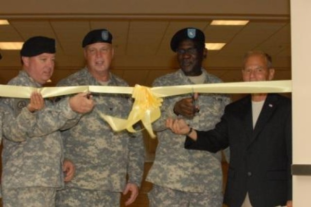 From left to right, Col. George G. Bugg, 143rd Sustainment Command (Expeditionary) Rear Detachment Commander, Col. Scottie D. Carpenter, Lt. Col. Matthew T. Sims, director of the 469th FMC, and Col. (Ret.) Michael Bendich cut the ribbon to officially rededicate the opening of the James H. Diamond United States Army Reserve Center in New Orleans, La., May 17.