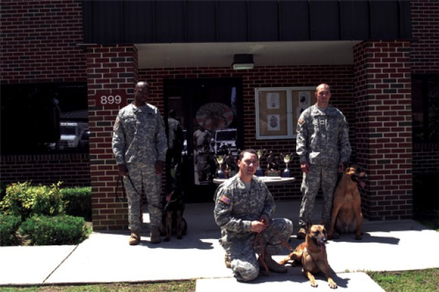 The teams pose in front of the kennels with the competition awards. (From left) Staff. Sgt. Joshua Washington with MWD Clara, Sgt. Brandon Beene and MWD Chay, and Staff Sgt. Allen Chrans and MWD Jings.