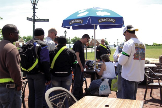 Riders line up to receive their first playing card at Ben and Jerry's Ice Cream at Yorktown Beach, the first stop on the poker run.