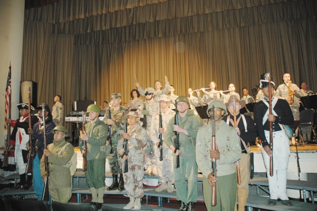 """A pageant of Soldiers dressed in period uniforms was part of the U.S. Army Materiel Command Band's concert, """"Esprit de Corps,"""" a tribute to the Year of the Noncommissioned Officer held at the Aberdeen Proving Ground Post Theater May 15."""