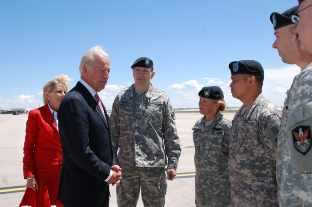 Vice President Joe Biden talks with members of ARSST 26 during a visit to Colorado Springs on the afternoon of May 27. Seen in the back ground left to right are: Dr. Jill Biden; Maj. Tod Fenner, team leader; Maj. Janet Schoenberg, Space operations officer; Staff Sgt. James Smith, intelligence analyst; and Spc. David Wilde, satellite communications. ARSST 26 is part of the 117th Space Battalion, Colorado Army National Guard, 1st Space Brigade. Their mission is to provide space-based products and capabilities to the warfighter.