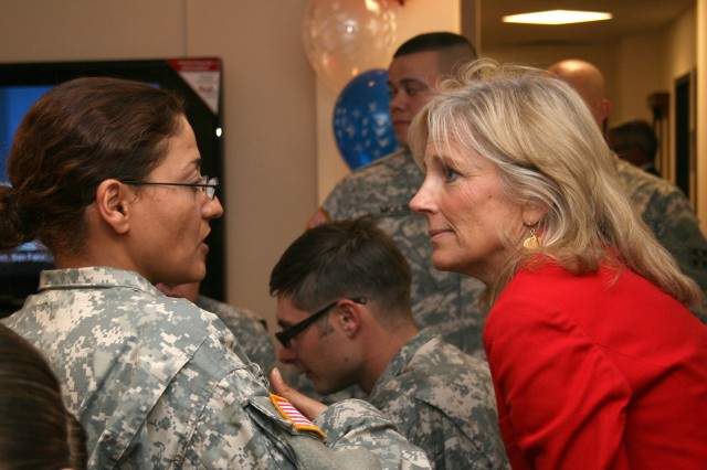 FORT CARSON, Colo.-Dr. Jill Biden, wife of Vice President Joe Biden, listens to Spc. Hanan Shaban, 230th Finance Battalion, 43rd Sustainment Brigade, during a visit to the Mountain Post Wednesday.