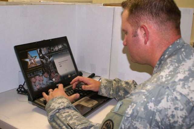Schofield Barracks Health ClinicAca,!a,,cs Sgt. Troy Wollan, SELF program NCOIC, runs a computer test on a laptop used by Soldiers taking the SELF health survey.