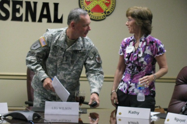 Kathy Campbell, wife of SMDC commander Lt. Gen. Kevin Campbell, thanks Lt. Gen. Robert Wilson, commander of the Installation Management Command, for the time he took to meet with a wide range of military spouses living on or near Redstone Arsenal. The meeting with spouses was part of Wilson's itinerary during his May 20 visit to the Arsenal.