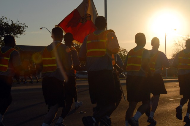 Noncommissioned officers of the 15th Sustainment Brigade, 13th Sustainment Command (Expeditionary) run on Battalion Ave. during a brigade NCO run here, May 21. (U.S. Army photo by Sgt. Matthew C. Cooley, 15th Sustainment Brigade Public Affairs)