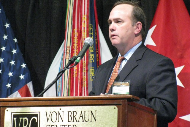 C. Stephen Cornelius, AMRDECAca,!a,,cs associate director for missile development, talks at the AUSA Tactical Missiles Conference about the benefits of synergy between Redstone Arsenal and local industry in the development of new weapons capabilities.