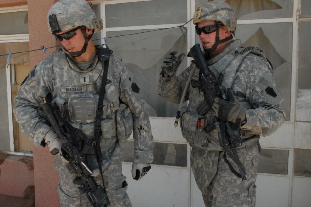 BAGHDAD - Lt. Michael Keckler (left), of Bel Air, Md., and 1st Sgt. Harry Buchanan of Altoona, both with Company B, 2nd Battalion, 112th Infantry Regiment, 56th Stryker Brigade Combat Team, discuss an ongoing search for explosives, May 19. The Soldiers were hunting for vehicle-borne IED-making materials in an area where VBIEDS have posed a threat to Soldiers and civilians alike in the past.