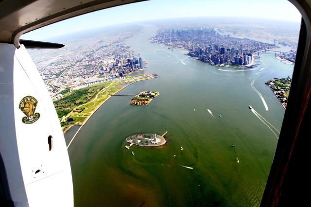 The U.S. Army Parachute Team makes a final approach toward Liberty Island for the Memorial Weekend demonstration jump.