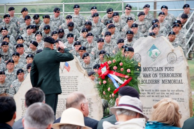 FORT CARSON, Colo.-A Soldier renders honors during the roll call of fallen Fort Carson Soldiers.