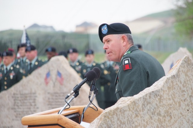 FORT CARSON, Colo.-Maj. Gen. Mark A. Graham, commanding general, Division West (First Army) and Fort Carson, addresses the Families of fallen Fort Carson Soldiers during the May 21 GWOT Memorial service.