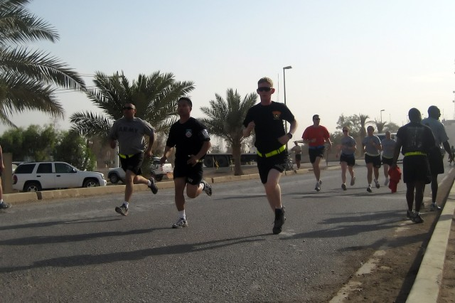 BAGHDAD - Runners on the final stretch sprint to the finish line at the Asian Pacific Heritage five kilometer run on Victory Base Complex May 16. Soldiers from the 299th Brigade Support Battalion, 2nd Heavy Brigade Combat Team, 1st Infantry Division, Multi-National Division-Baghdad hosted the run, which was meant to boost camaraderie among Soldiers deployed to Iraq.