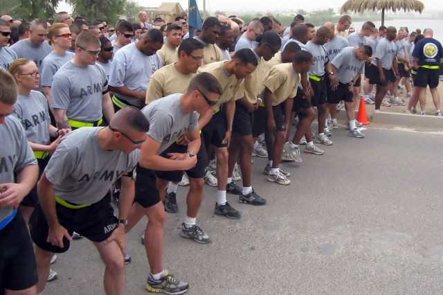 """BAGHDAD - Soldiers prepare to start off the """"Year of the NCO"""" run at Z-Lake on Victory Base Complex May 9. Soldiers from the 299th Brigade Support Battalion, 2nd Heavy Brigade Combat Team, 1st Infantry Division, Multi-National Division - Baghdad hosted the event, which highlighted the accomplishments of NCO's in the U.S. Army's history."""