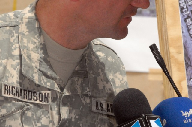 """BAGHDAD - Lt. Col. John Richardson, of Tallahassee, Fla., commander of the 5th Squadron, 4th Cavalry Regiment, 2nd Brigade Combat Team, 1st Infantry Division, gives a speech during a Ghazaliyah improvement ceremony, May 20. """"Today we honor the efforts of the leaders of Iraq for improving their community,"""" said Richardson.  """"The combined efforts of the Iraqi Security forces, the Government of Iraq and the Coalition force made these improvements happen and will continue to be the driving force for the return to normalcy in Baghdad."""""""