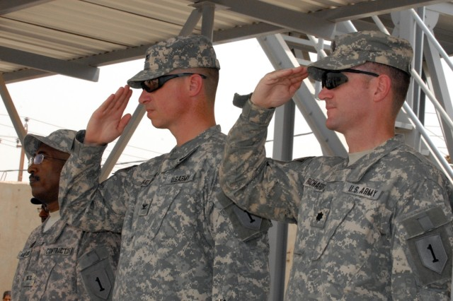 """BAGHDAD - Col. Joseph Martin (left), from Dearborn, Mich. and commander of the 2nd Brigade Combat Team, 1st Infantry Division and Lt. Col. John Richardson, of Tallahassee, Fla., commander of 5th Squadron, 4th Cavalry Regiment, 2nd BCT, 1st ID, salute during the Iraqi National Anthem.  """"Ghazaliyah has come a long way because of the tireless efforts of the local leaders and the Iraqi Security Forces,"""" said Richardson.  """"They now have the momentum and are progressing every day,"""" he added."""