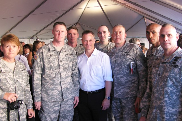 Actor and executive producer Gary Sinise took time to meet with service members and sign autographs at the reception prior to the screening. Here he poses for a shot with a handful of Fort Huachuca Soldiers.
