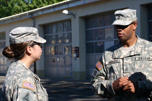 Sgt. 1st Class Dontonio Roberts, the first sergeant for Company D, 172nd Brigade Forward Support Battalion, provides guidance to Sgt. Mabel Fryberger in Schweinfurt, Germany.