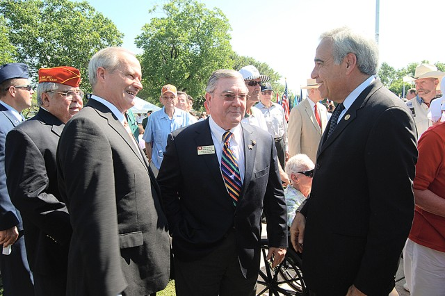 (From left) Bexar County Commissioner Tommy Adkisson Precinct 4, Richard Kleberg, civilian aide to Secretary of the Army and Congressman Charles Gonzalez, District 20 of Texas, visit following the Memorial Day Ceremony at the Fort Sam Houston National Cemetery. Kleberg was the keynote speaker for the ceremony.