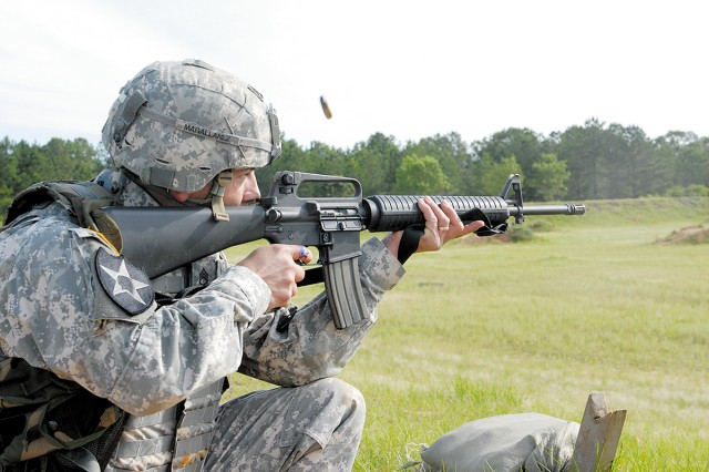 FORT GORDON, Ga.--(May 22, 2009) Brass flies as Staff Sgt. Mathew Magallanez, 116th Military Intelligence Group focuses downrange while firing at targets during the marksmanship event May 19.