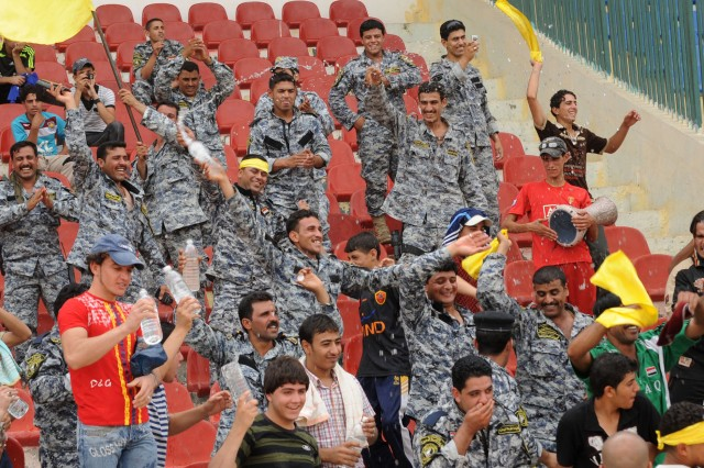 BAGHDAD - National Police officers cheer following a goal during a game a FC Unity soccer game at Shaab Stadium May 22 in the Rusafa district of eastern Baghdad. Four combined U.S. - Iraqi forces matches were played during the tournament in which mixed U.S. - Iraqi teams competed against each other. The teams were assembled by the districts in which they work in. A total of 36 games are being played during the weekend tournament.
