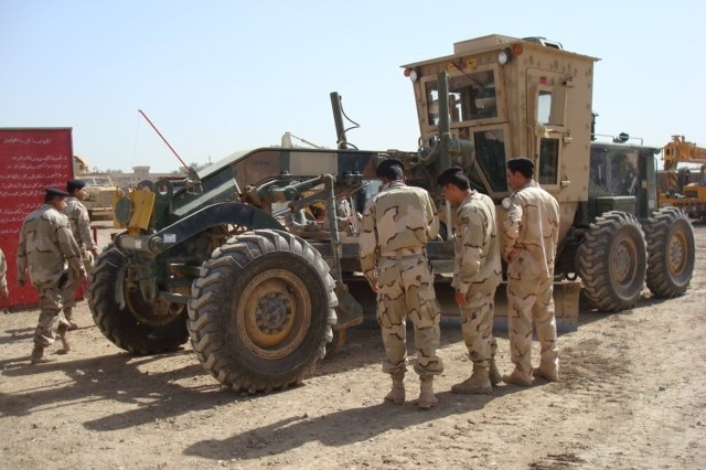 BAGHDAD - Iraqi Army engineers get a close look at a grader.  These Soldiers received classes on basic operation techniques as well as safety procedures in the Rasheed district of Baghdad.