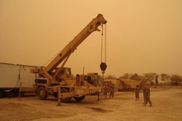 BAGHDAD - Soldiers from Company A, 46th Engineer Combat Battalion (Heavy), 225th Eng. Brigade,  watch as an Iraqi Army engineer operates a crane.