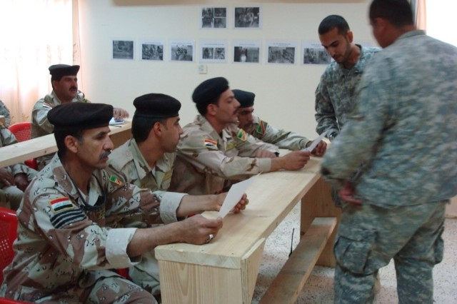 BAGHDAD - Spec. Leobardo Antonio, from Phoenix, Ariz., with 46th Engineer Combat Battalion (Heavy), 225th Eng. Brigade, gives classroom instruction on operating a grader to 9th Iraqi Army engineers.