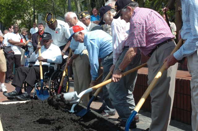 Local veterans, many of whom are well into their nineties, took turns turning the soil where the new WWII monument will stand on River Street in downtown Savannah, May 25.
