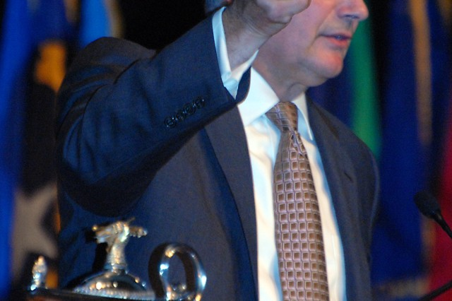 Retired Lt. Gen. James Dubik holds up his one remaining piece of family crystal before passing it among the graduating students and faculty during School of Advanced Military Studies graduation May 21 in Eisenhower Auditorium. Dubik, who delivered the graduation address, used the fragile glass as a metaphor that as SAMS graduates and faculty they now hold something much more important than his heirloom.