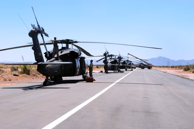 Soldiers from CAB work on Black Hawks during Task Force Lighthorse's rotation at Falcon Focus, May 13. Falcon Focus is a training event designed by the CAB that takes place at Camp McGregor on Fort Bliss, Texas, and incorporates each of the CAB's battalions and squadron over the course of two months.