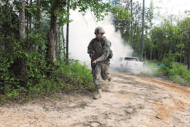 PVT Chad Kennedy runs out of smoke from a simulated IED attack.