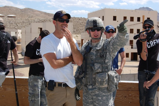 Brig. Gen. Robert Abrams, National Training Center and Fort Irwin commanding general, shows TV personality Carson Daly some of Medina Jabl's features during Daly's visit to the National Training Center at Fort Irwin, Calif., May 27.