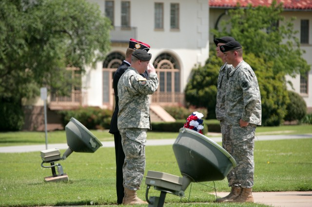 Brig. Gen. Ross Ridge, Fort Sill deputy commanding general and assistant commandant of the Field Artillery School, and Bob Tryan, local VFW commander, salute a wreath honoring service members who died for their country during a ceremony May 25.