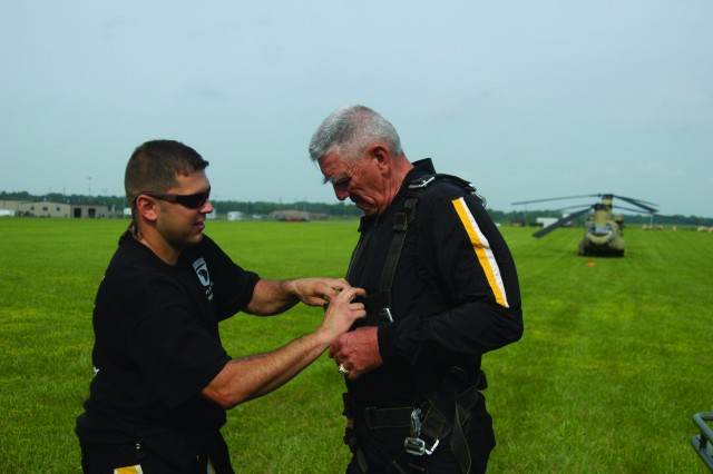 "Sgt. 1st Class Larry Jarrett, 101st Airborne Division Parachute Demonstration Team, prepares R. Lee Ermey for a tandem jump out of a CH-47F Chinook helicopter. Ermey, best known for his role as a drill instructor in ""Full Metal Jacket"" and host of ""Mail Call"" was at Fort Campbell to film an episode of his new show ""Lock and Load."""