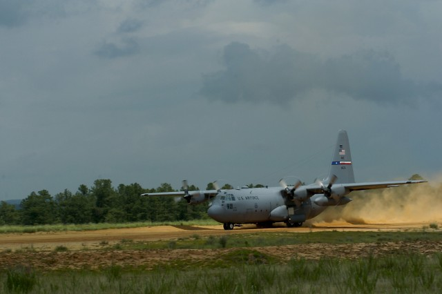 A C-130 Hercules aircraft takes off from Sicily Drop Zone at Fort Bragg, N.C., May 28. On board are roughly 60 paratroopers from the XVIII Airborne Corps who are about to take part in an airborne operation for the first time in nearly 16 months.