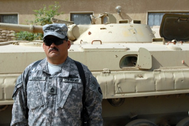 """CAMP VICTORY, Iraq - Master Sgt. Ralph Amaya, the master gunner and operations sergeant major for the 56th Infantry Brigade Combat Team, Multi-National Division-Baghdad, listens to the publishing of the order awarding him his second award of the Combat Infantryman Badge during an award ceremony held on May 23.  Amaya, from Killeen, Texas remarked that he felt """"humbled to receive this award."""""""
