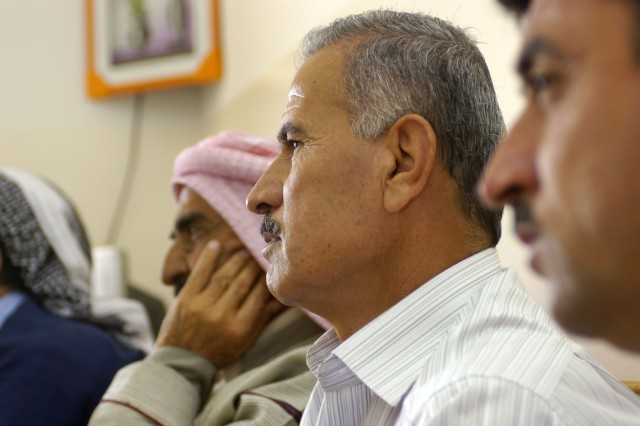 An Iraqi farmer listens intently during a small group discussion relating to the agricultural market in the Shekhan district. Farmers were given an opportunity to discuss the agriculture in their communities and address issues that, if resolved, would provide more economic stability in the region.