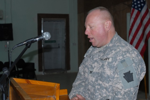 CAMP TAJI, Iraq - Chaplain (Col.) Bert Kozen, brigade chaplain, from Williamsport Pa., presides over the Memorial Day services, May 25, at the Warrior Chapel for Soldiers of the 56th Stryker Brigade Combat Team, 1st Cavalry Division, Multi-National Division-Baghdad.